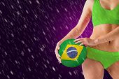 Fit girl in green bikini holding brasil ball against pink vignette poster