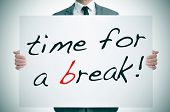 businessman holding a signboard with the text time for a break written in it poster