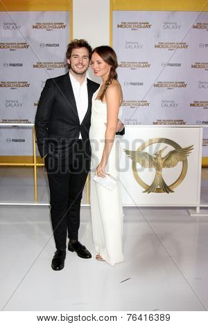 m LOS ANGELES - NOV 17:  Sam Claflin, Laura Haddock at the The Hunger Games: Mockingjay Part 1 Premiere at the Nokia Theater on November 17, 2014 in Los Angeles, CA