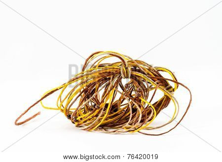 Tangled Of Rope Twist Together Into A Confused Mass On White Background