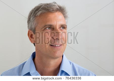 Portrait Of Thoughtful Mature Man Thinking About His Future