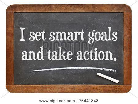 I set smart goals and take action - positive affirmation words on a vintage slate blackboard