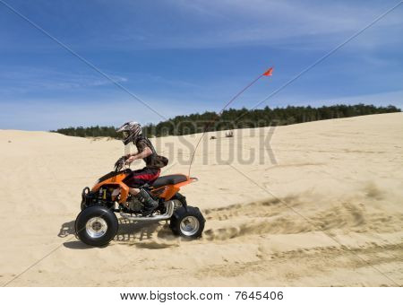 Speeding Quad In Sand Dunes