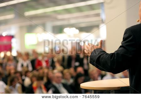 audience is listening to the orator in public poster