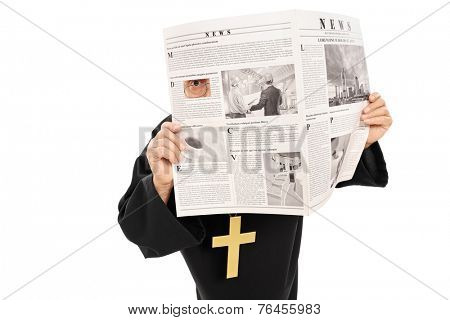 Sneaky priest peeking through a hole in newspaper isolated on white background