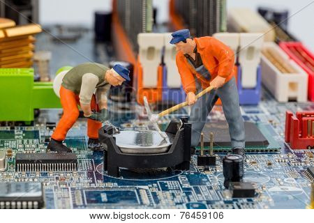computer board and workers, symbolic photo for computer failure, maintenance, data security
