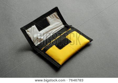 A yellow nylon purse