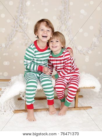 Winter Holidays: Laughing Happy Kids In Christmas Pajamas Sled In Snow