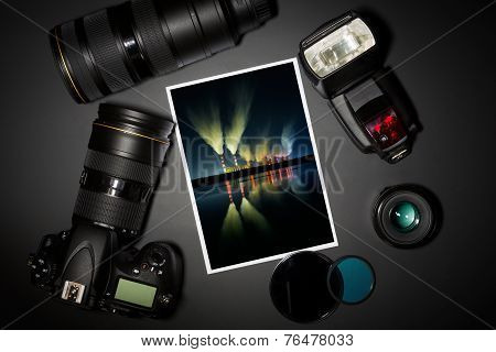 Camera Lens And Image On Black Background