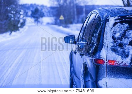 Car covered with snow.