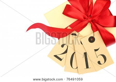 Gift box with red bow and tags with new year 2015 isolated on white