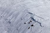 Off-piste with snow cornice and stones. Caucasus Mountains Georgia. Ski resort Gudauri. poster
