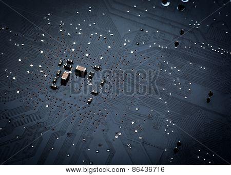 Close up of a printed black computer circuit board