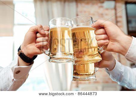 Three glasses of beer in focus