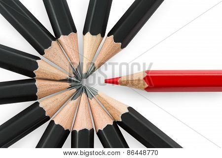 Red Pencil Standing Out From The Circle Of Black Pencils