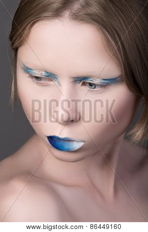 Portrait Of Young Beautiful Girl With Blue Lips