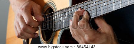 Acoustic Guitar Player Performing Song