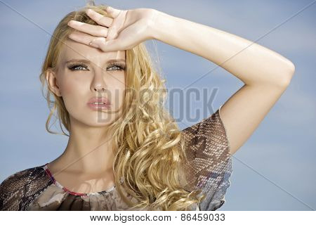 portrait of beautiful young adult attractive sexy and sensuality pretty blonde girl on background blue sunlight sky