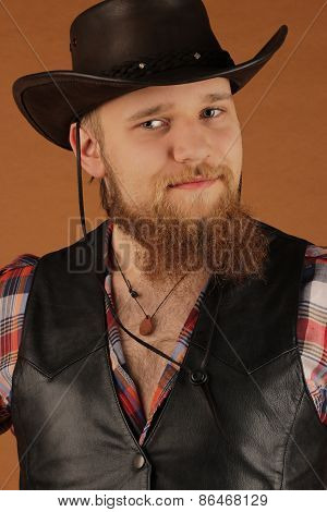 Portrait of the young man of the cowboy