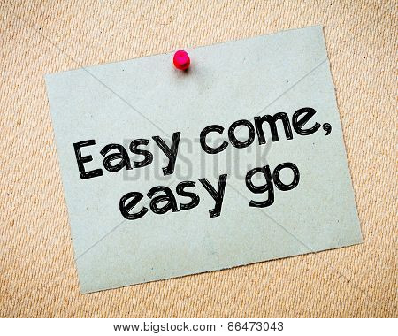 Easy come easy go Message. Recycled paper note pinned on cork board. Concept Image poster