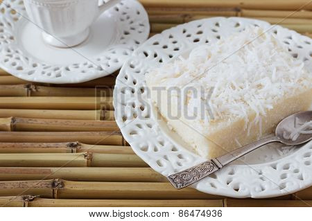 Sweet Couscous Pudding (cuscuz Doce) Coconut On Vintage Plate, Cup Of Coffee On Bamboo