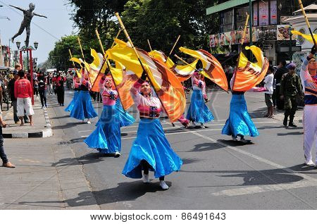 Women presenting flags, Yogyakarta city festival parade