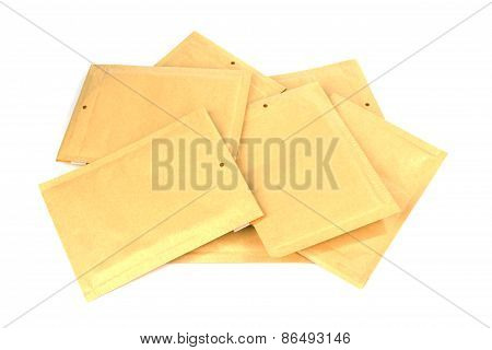Pile different size bubble lined shipping or packing envelopes poster