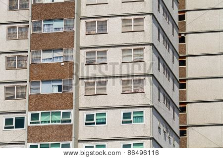A repetitive dull social residential building with beige and brown colours poster