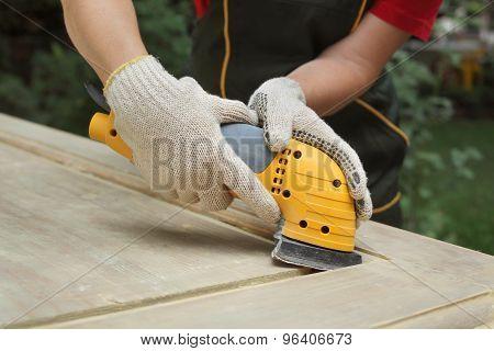 Home Renovation, Worker Sanding Wooden Door