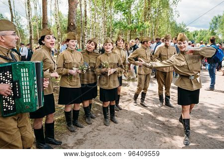 Artists dressed as Soviet Russian soldiers dance during events