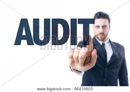 Business man pointing the text: Audit poster