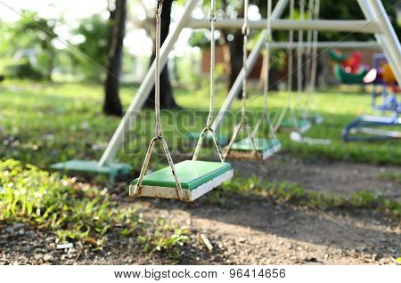 Old Metal And Wooden Swing Chair  On The Playground In The Park