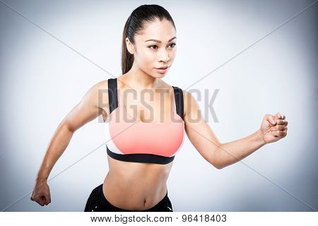 Sporty Asian Girl Running Pose