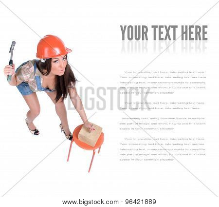 Young woman holding hammer and nail
