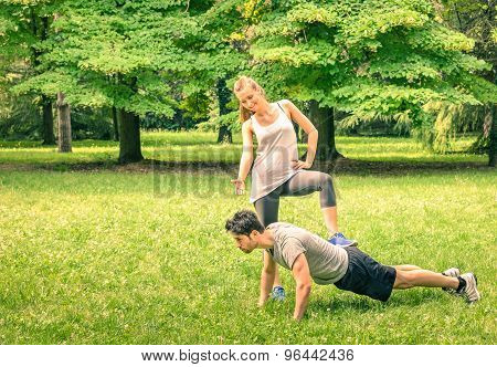 Girlfriend Mocking Her Boyfriend While Training In The Park - Young Man And Woman At Spring Workout