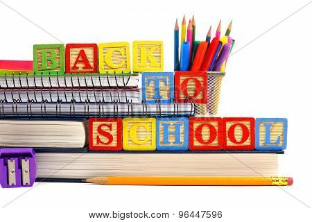 Back to School wooden toy blocks on books with school supplies
