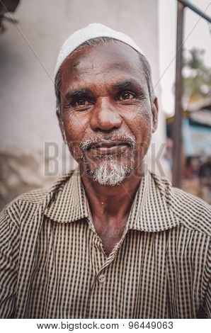 KAMALAPURAM, INDIA - 02 FABRUARY 2015: Middle-aged Indian man with a religious cap. Post-processed with grain, texture and colour effect.