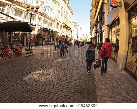 Prague, Czech Republic - April 21, 2015: Citizens And Tourists Walk The Streets Of Prague