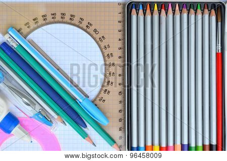 Stationery - colored pencils, protractor, ruler, brush painting poster