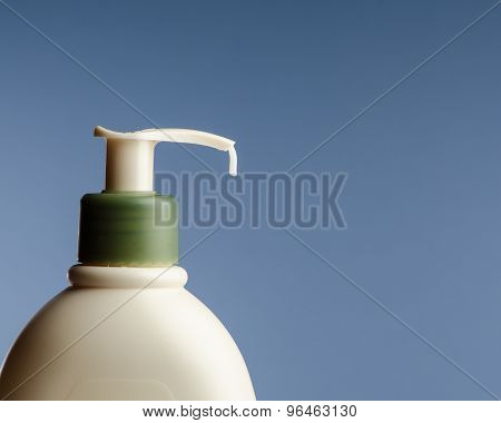 lotion bottle with a drop of lotion coming out poster