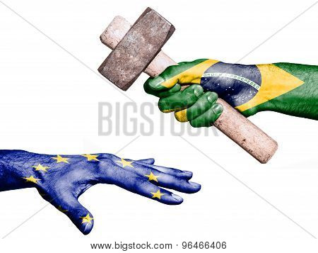 Flag of Brazil overprinted on a hand holding a heavy hammer hitting a hand representing the European Union. Conceptual image for political fiscal or social aggressions penalties taxation poster