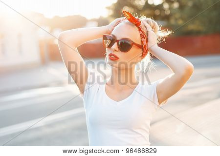 Beautiful Hipster Woman With Red Lips And Sunglasses Standing In The Street At Sunset