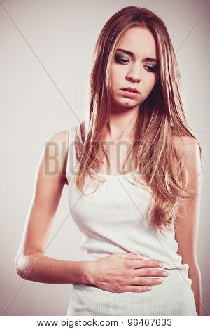 Girl Suffering From Stomach Pain