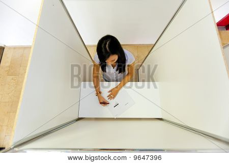 Woman In A Voting Booth