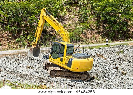 Excavator Digging Rock On Constriction Site