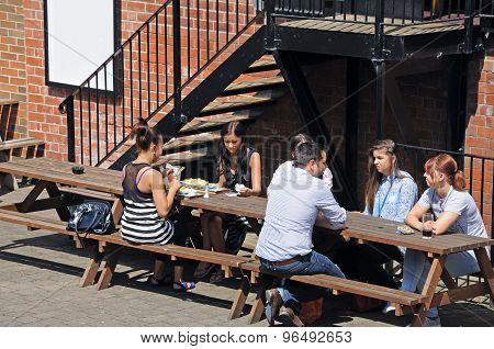 People sitting outside pub, Nottingham.
