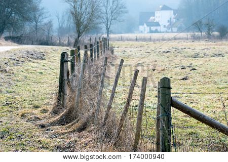 very abandoned barbed wire fence in nature