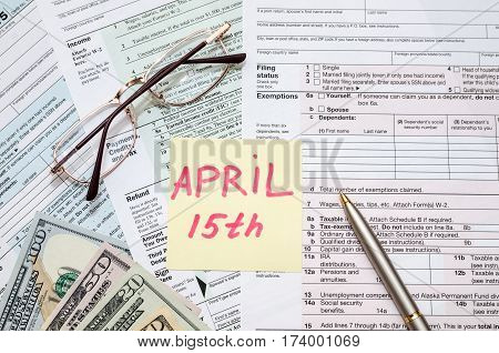 Official USA tax form 1040 calculator pen and dollar and the day tax april 15
