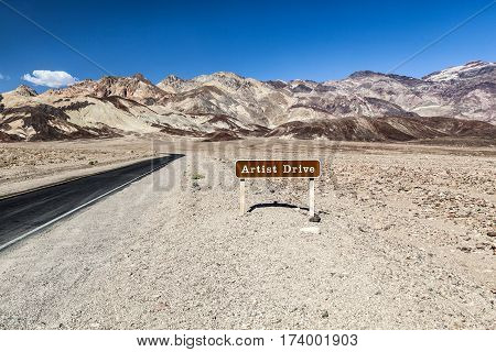 Desert Landscape Narrow Road And Sign Of The Scenic Artist Drive In The Death Valley National Park
