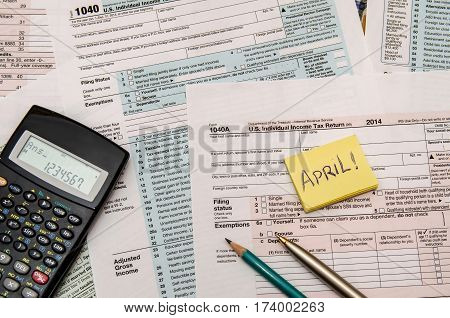 1040 Tax Form with pen calculator close up